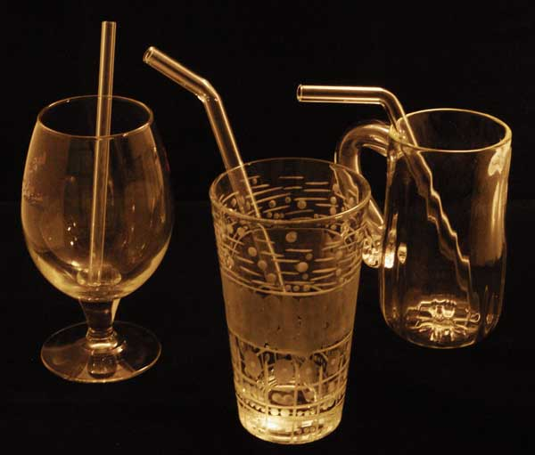 Drinking Glasses with Glass Straws in them.